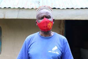 The Water Project: Buhayi Community, Nasichundukha Spring -  Joseph With His Mask On