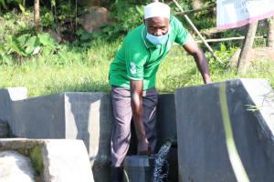 The Water Project: Mahira Community, Kusimba Spring -  Joshua Kusimba Fetching Water At The Spring