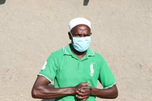 The Water Project: Mahira Community, Kusimba Spring -  Mr Kusimba With A Face Mask On