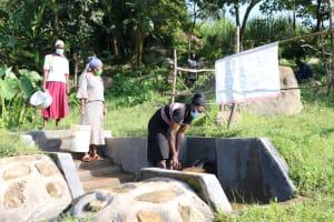 The Water Project: Mahira Community, Kusimba Spring -  Social Distancing At The Spring