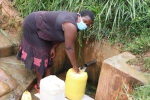 The Water Project: Shitaho Community B, Isaac Spring -  Rosemary At Isaac Spring Fetching Water