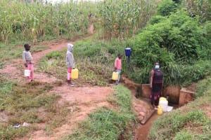 The Water Project: Shitaho Community B, Isaac Spring -  Social Distancing At The Spring
