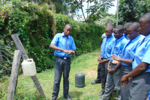 The Water Project: Malinda Secondary School -  A Student Shows Ten Handwashing Steps
