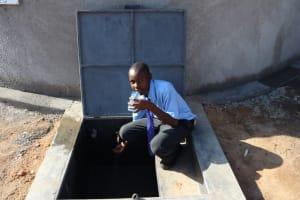 The Water Project: Malinda Secondary School -  Enjoying A Fresh Drink From The Rain Tank