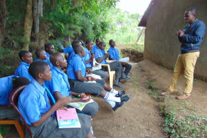 The Water Project: Malinda Secondary School -  Pupils Listen To Trainer Samuel