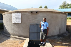 The Water Project: Malinda Secondary School -  Student Drinking Water