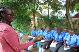 The Water Project: Malinda Secondary School -  Trainer Olivia Demonstrates Toothbrushing