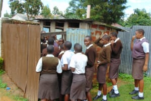 The Water Project: Friends Kisasi Secondary School -  Girls Lined Up At Their Latrines