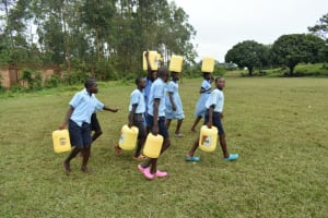 The Water Project: Isango Primary School -  Students Carrying Water