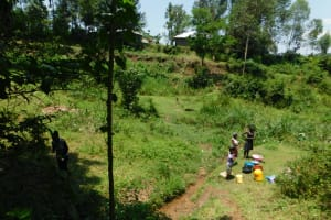 The Water Project: Emutetemo Community, Lubale Spring -  Doing Some Laundry