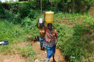 The Water Project: Mukhweso Community, Shemema Spring -  Taking Water Home