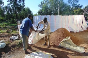 The Water Project: Kapkoi Primary School -  Knitting Sacks Onto Wire For Cement Reinforcements