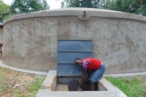 The Water Project: Boyani Primary School -  School Staff Member At The Rain Tank
