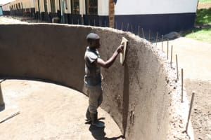 The Water Project: Friends School Shivanga Secondary -  Smoothing The Plaster Inside The Tank