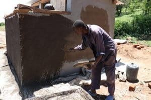 The Water Project: Friends School Shivanga Secondary -  Roughcasting Latrine Walls