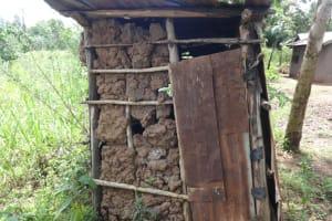 The Water Project: Mahira Community, Anunda Spring -  A Mud Walled Latrine