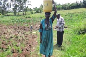 The Water Project: Mahira Community, Anunda Spring -  Agnes Kutoto Carrying Water From Anunda Spring