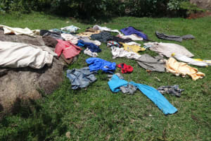 The Water Project: Mahira Community, Anunda Spring -  Clothes Drying On Grass
