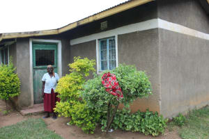 The Water Project: Nguvuli Community, Busuku Spring -  Rose Shangu Outside Her Homestead