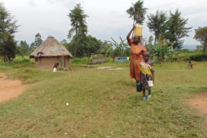 The Water Project: Nguvuli Community, Busuku Spring -  Rose And Faith Carrying Water