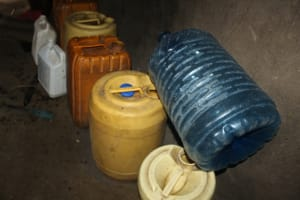 The Water Project: Nguvuli Community, Busuku Spring -  Water Storage