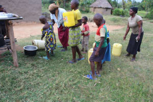 The Water Project: Nguvuli Community, Busuku Spring -  Community Members Fetching Water