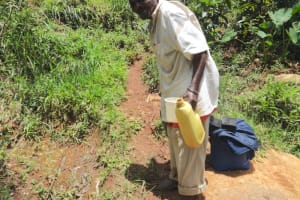 The Water Project: Shihome Community, Peter Majoni Spring -  Carrying Water From The Unprotected Spring