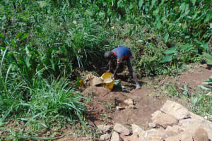The Water Project: Indulusia Community, Yakobo Spring -  Collecting Water From The Spring