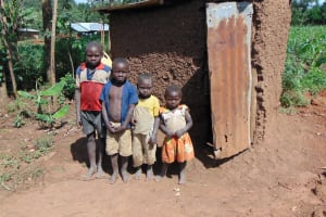The Water Project: Indulusia Community, Yakobo Spring -  Kids Lined Up Outside A Latrine
