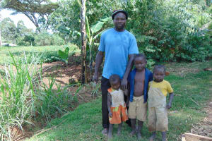 The Water Project: Indulusia Community, Yakobo Spring -  Mr Alfred Isaiah With His Kids