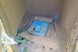 The Water Project: Indulusia Community, Yakobo Spring -  Plastic Cover Inside Latrine