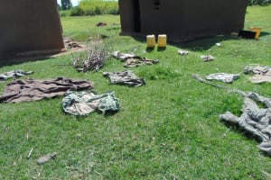 The Water Project: Indulusia Community, Yakobo Spring -  Airing Colthes On The Ground