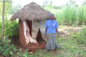 The Water Project: Makale Community, Luyingo Spring -  Beatrice Outside Her Latrine