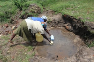 The Water Project: Makale Community, Luyingo Spring -  Collecting Water At Luyingo Spring