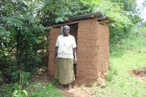 The Water Project: Makale Community, Luyingo Spring -  Community Member At Her Latrine