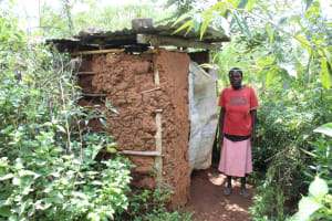 The Water Project: Makale Community, Luyingo Spring -  Outside Her Latrine