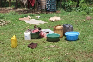 The Water Project: Makale Community, Luyingo Spring -  Water Containers And Laundry Underway