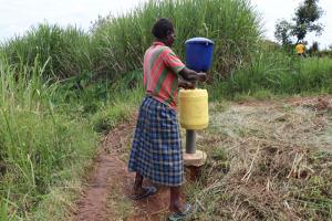 The Water Project: Shitavita Community, Patrick Burudi Spring -  Adding Chlorine To Water