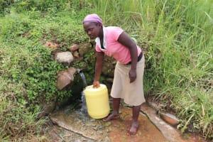 The Water Project: Shitavita Community, Patrick Burudi Spring -  Collecting Water