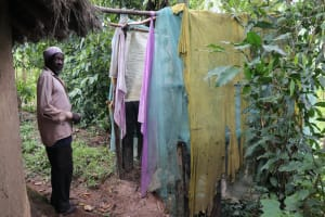 The Water Project: Shitavita Community, Patrick Burudi Spring -  In Front Of A Bathing Shelter