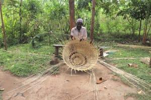 The Water Project: Shitavita Community, Patrick Burudi Spring -  Mr Burudi Weaving A Basket