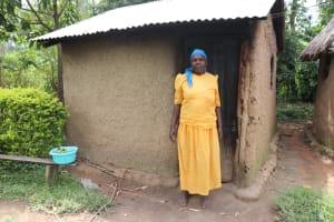 The Water Project: Shitavita Community, Patrick Burudi Spring -  Mrs Burudi Outside Her Kitchen