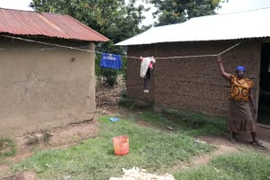The Water Project: Shitavita Community, Patrick Burudi Spring -  Pointing Out Her Clothesline