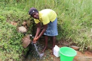 The Water Project: Shitavita Community, Patrick Burudi Spring -  Washing Hands Before Fetching Water