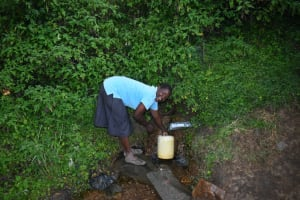 The Water Project: Silungai B Community, Tali Saya Spring -  Ruth Fetches Water
