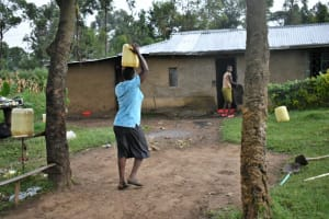 The Water Project: Silungai B Community, Tali Saya Spring -  Ruth Arrives Home With Water