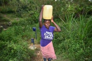 The Water Project: Mukhungula Community, Mulongo Spring -  Carrying Water