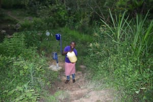 The Water Project: Mukhungula Community, Mulongo Spring -  Mounting Water On Her Head