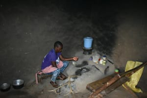 The Water Project: Mukhungula Community, Mulongo Spring -  Stoking The Fire Inside The Kitchen