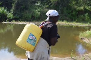 The Water Project: Kaketi Community B -  Carrying Water